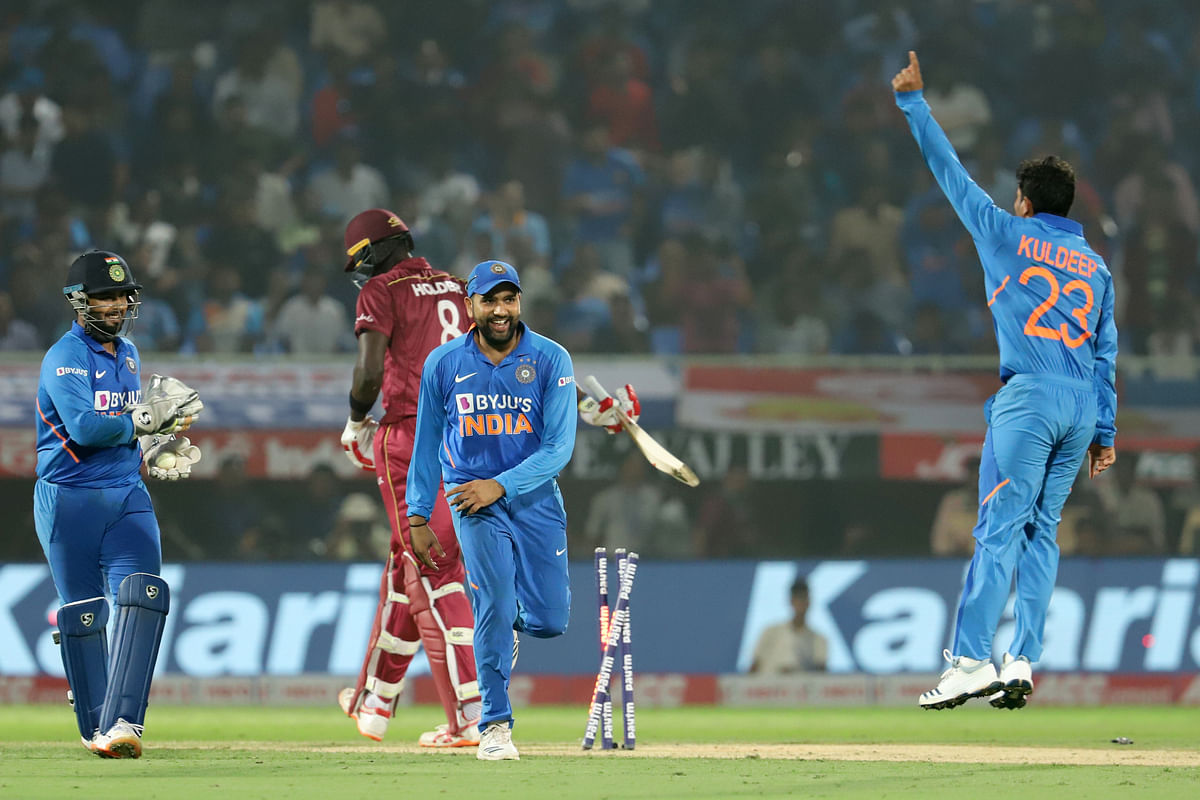 Kuldeep Yadav of India celebrates the wicket of Jason Holder of West Indies during the 2nd ODI between India and the West Indies.