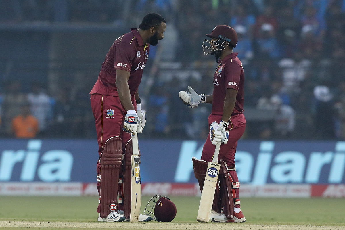 Kieron Pollard Captain of West Indies and Nicholas Pooran of West Indiesm during the 3rd ODI between India and the West Indies held at the Barabati Stadium, Cuttack on the 22nd December 2019.