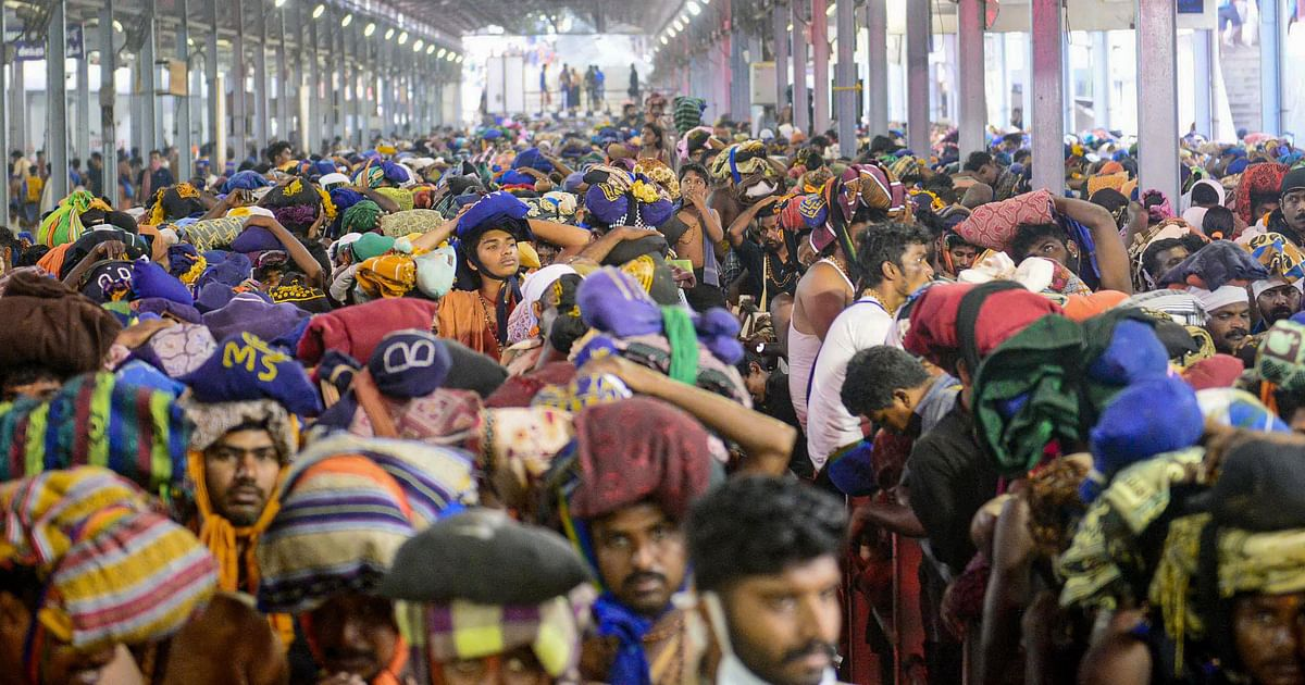 Devotees queue to offer prayers at Lord Ayyappa temple in Sabarimala on Tuesday, 24 December.