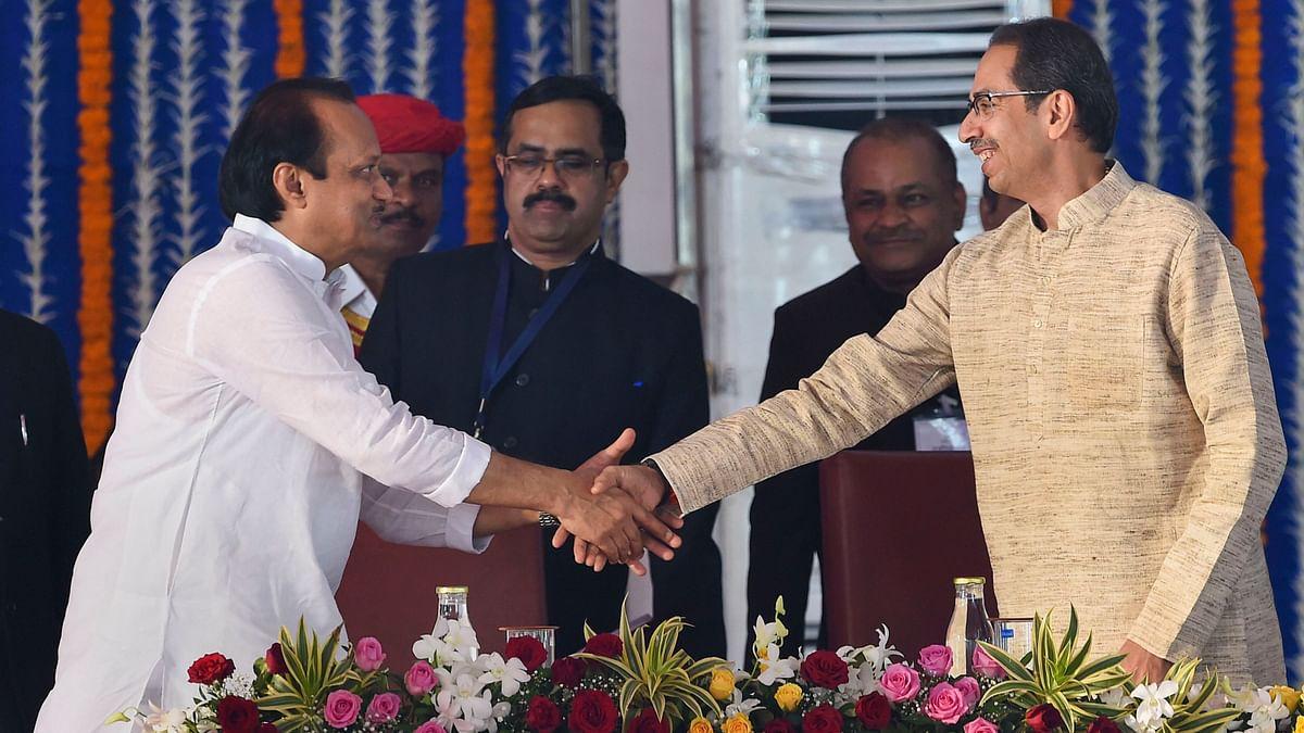 NCP leader Ajit Pawar shakes hands with Maharashtra Chief Minister Uddhav Thackeray.