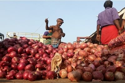 Chennai: Onions arrive at a wholesale market in Chennai on Dec 6, 2019. Onion prices have touched an all-time high with the vegetable being sold at Rs 140 a Kg in Chennai. (Photo: IANS)