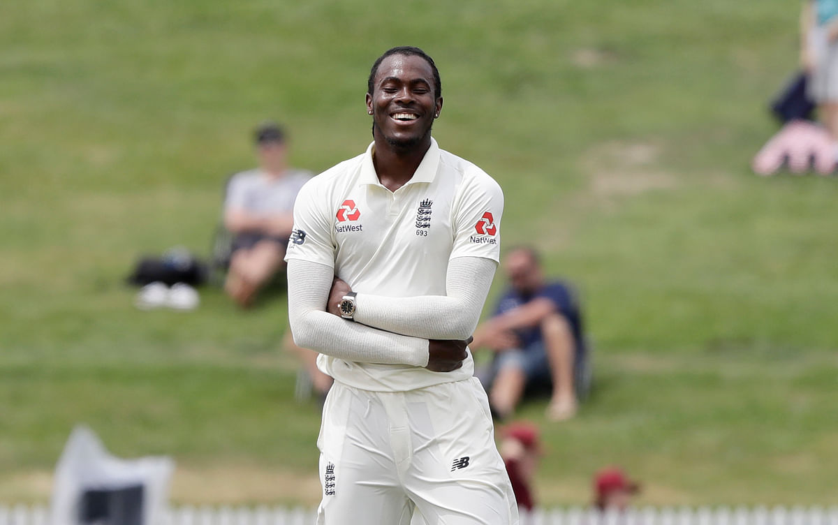 England's Jofra Archer reacts after teammate Joe Denly dropped a catch to dismiss New Zealand's Kane Williamson.