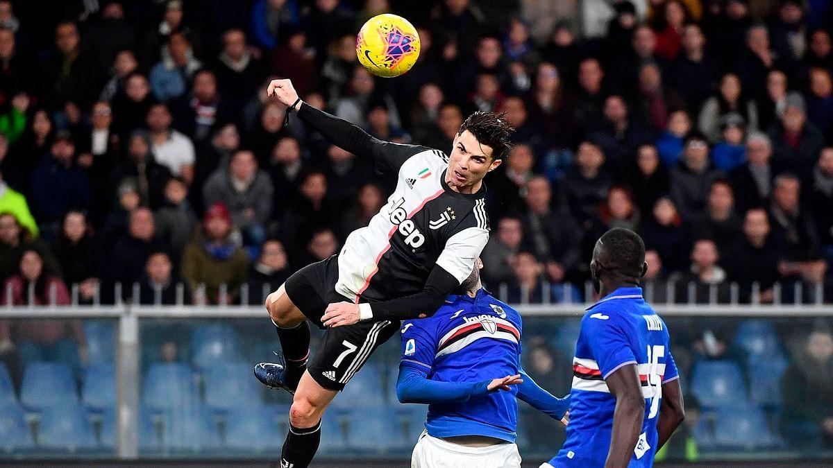 Juventus' Cristiano Ronaldo (L) scores the 1-2 goal during the Italian Serie A soccer match UC Sampdoria vs Juventus FC at Luigi Ferraris stadium in Genoa, Italy, 18 December 2019.