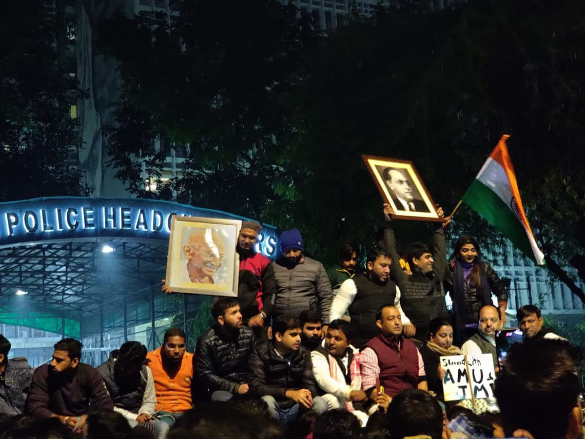 Protest against the police action at Delhi Police Headquarters.