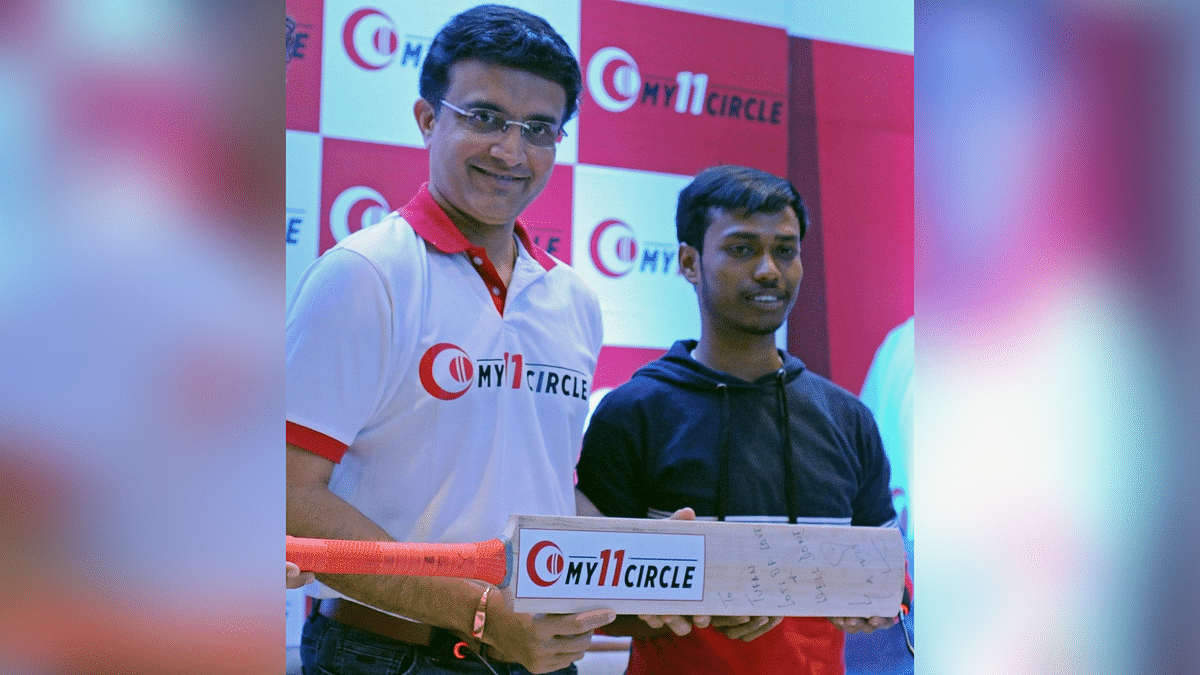 Sourav with Toofan Ghosh, the winner of the fantasy cricket league he endorses.