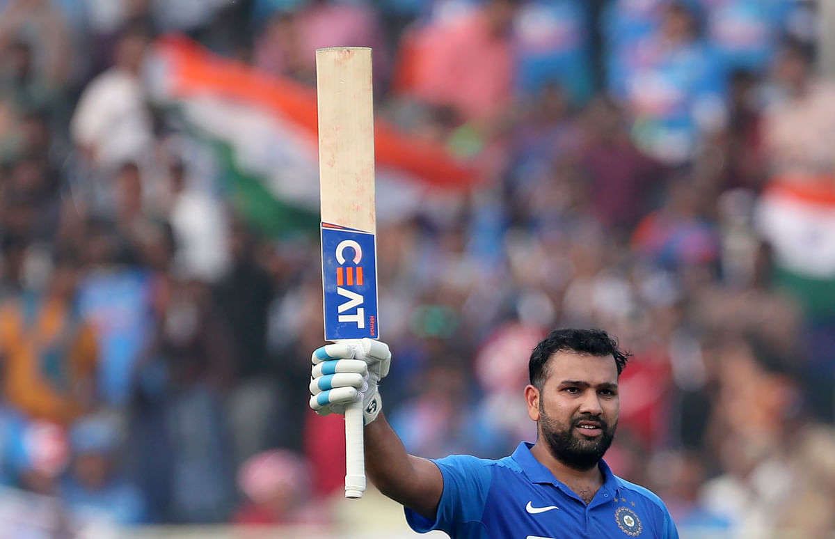India's Rohit Sharma raises his bat to celebrate scoring a century during the second one day international cricket match between India and West Indies in Visakhapatnam, India, Wednesday, Dec. 18, 2019.