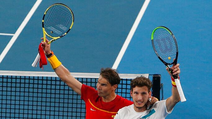 Rafael Nadal and Pablo Carreno Busta beat Sander Gille and Joran Vliegen 6-7, 7-5, 10-7 in the men's doubles tie on Friday.