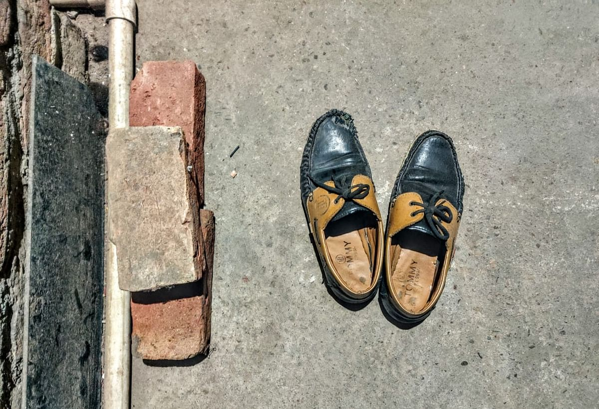 Anas' shoes lie unused in his home in Bijnor.