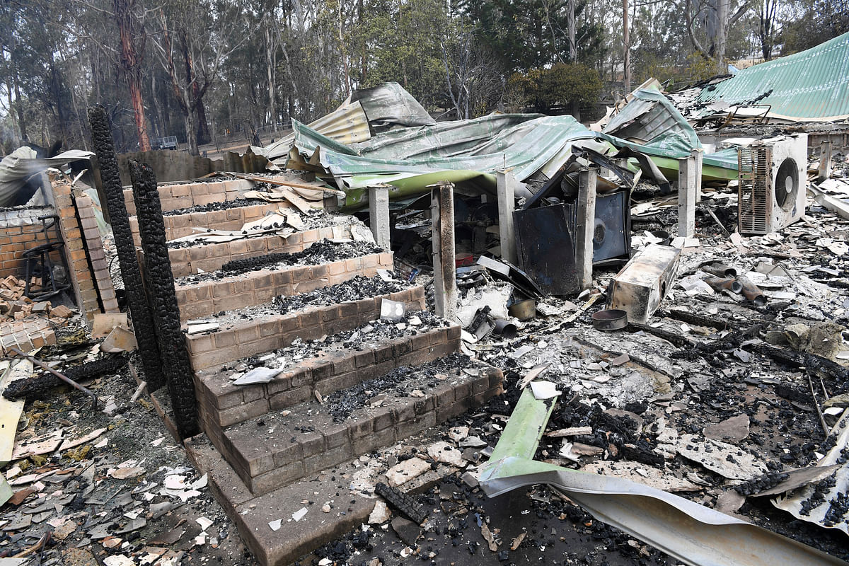 A burnt-out residence is seen in Sarsfield, East Gippsland, Victoria, Tuesday, 31 December, 2019.