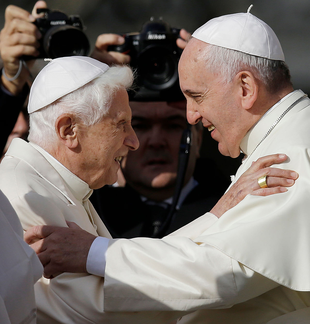 Pope Francis (right) and former Pope Benedict VI greeting each other in St Peter's Square at the Vatican on 28 September 2019.