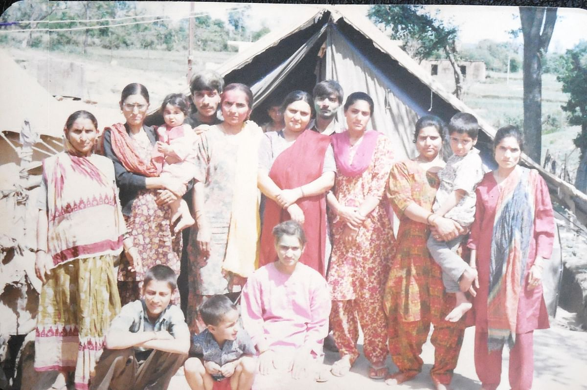 A displaced Kashmiri Pandit family next to their tent in the Garhi Camp, Udhampur, 1994.