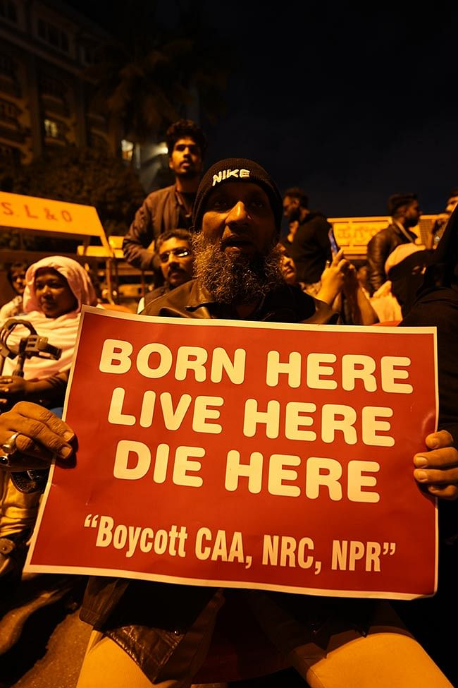A protester holding placard against the controversial Citizenship Amendment Act (CAA), National Registry of Citizens (NRC) and National Population Register (NPR).