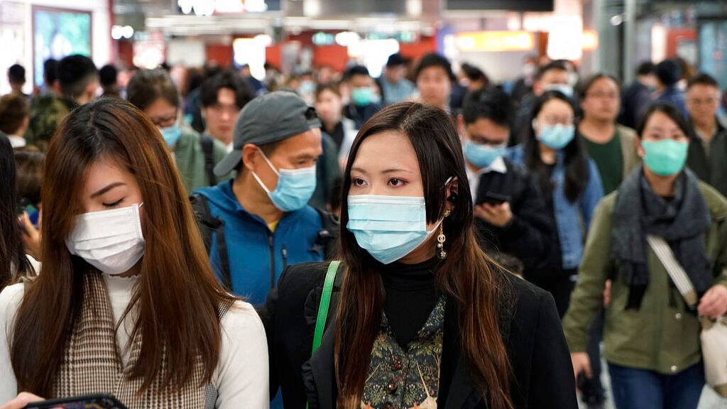 Passengers wear masks to prevent an outbreak of a new coronavirus in a subway station, in Hong Kong.