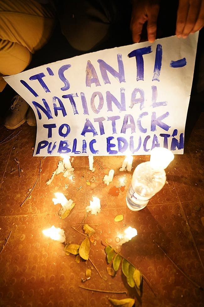 Protesters holding posters condemning the violence at JNU.