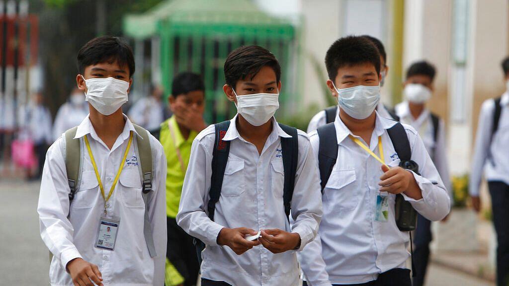 Students wear masks to avoid the contact of coronavirus in China's Cambodia.