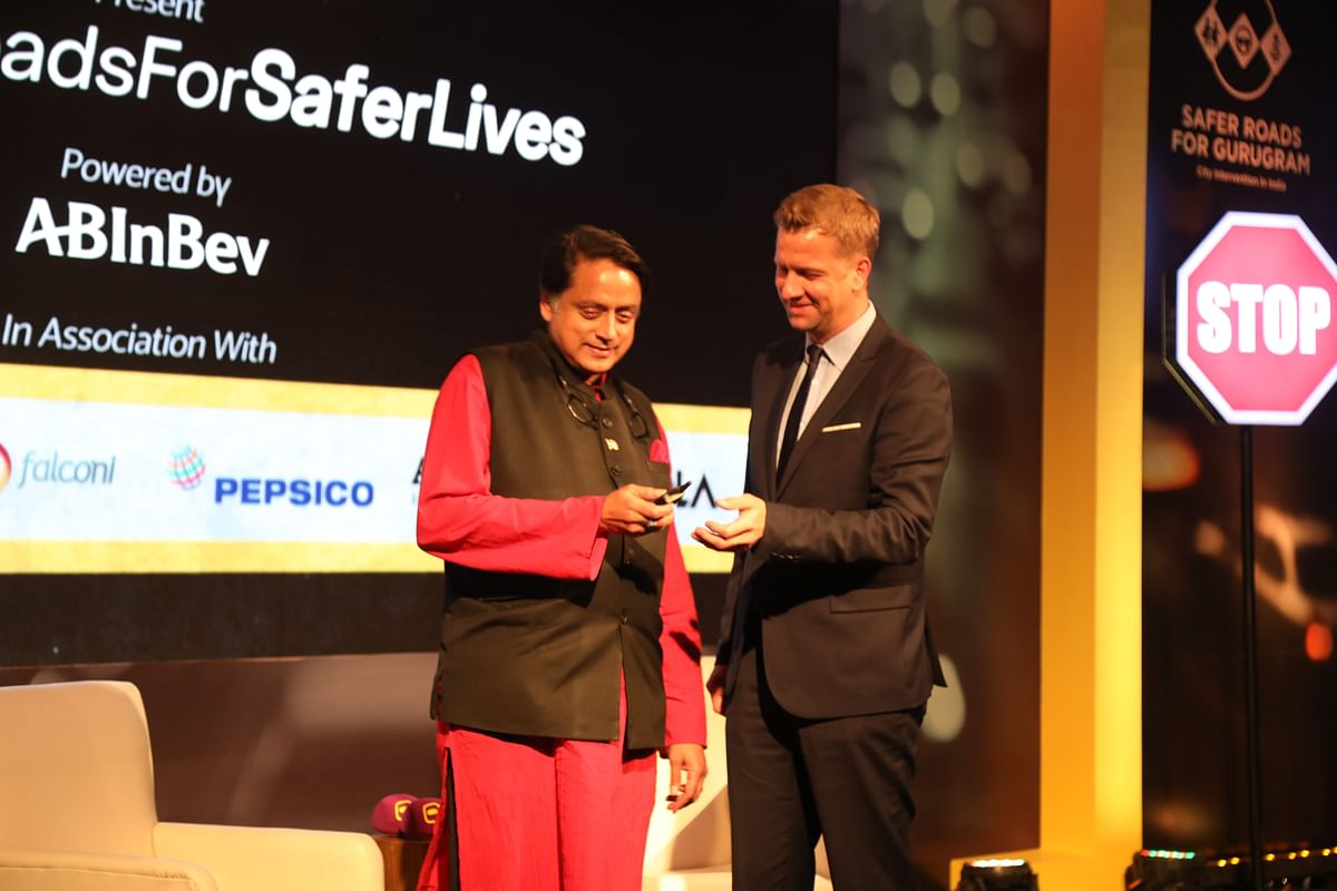 Congress MP Shashi Tharoor with Ben Verhaert, president of AB InBev's South Asian operations at the Safer Roads for Safer Lives event on December 3.