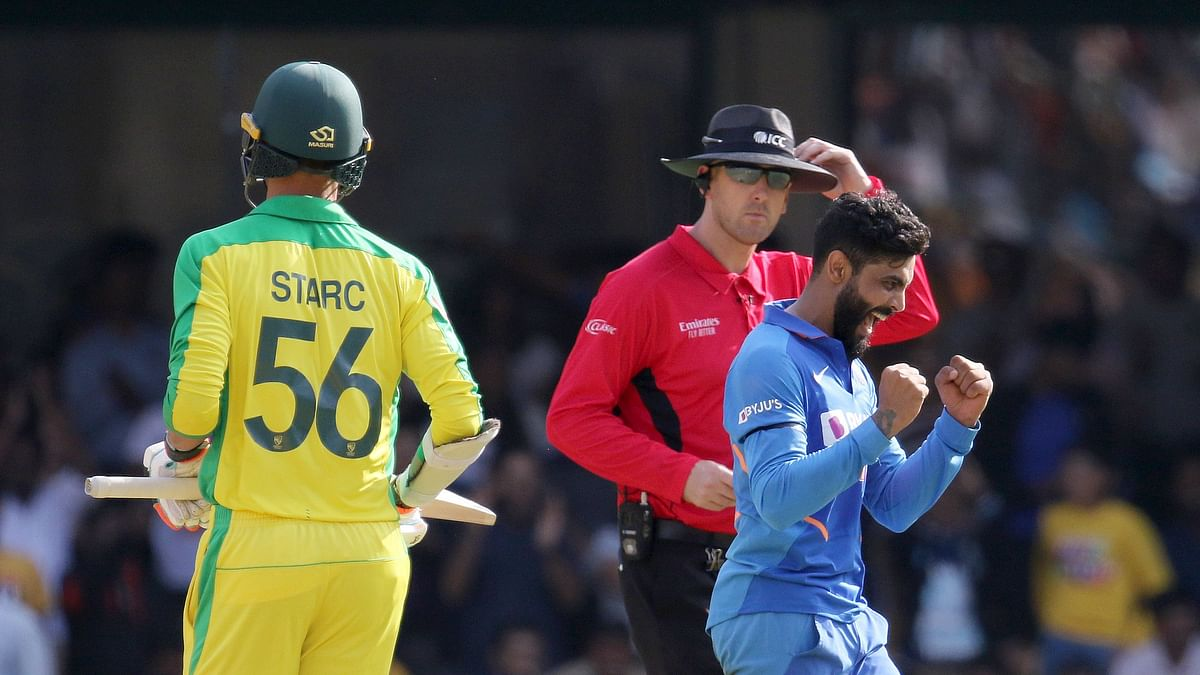 Ravindra Jadeja of India celebrates the wicket of Mitchell Starc of Australia during the 3rd One day International match between India and Australia.