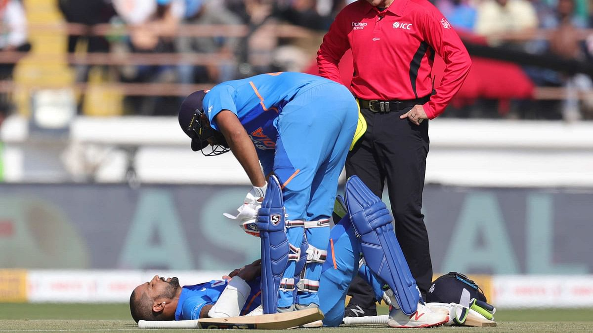 Shikhar Dhawan was hit on the rib cage in the 10th over of the Indian innings in the second ODI in Rajkot on Friday.