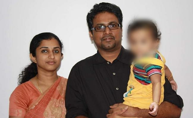 39-year-old Renjith Kumar TB  with his wife, 34-year-old Indu Renjith, and their child.