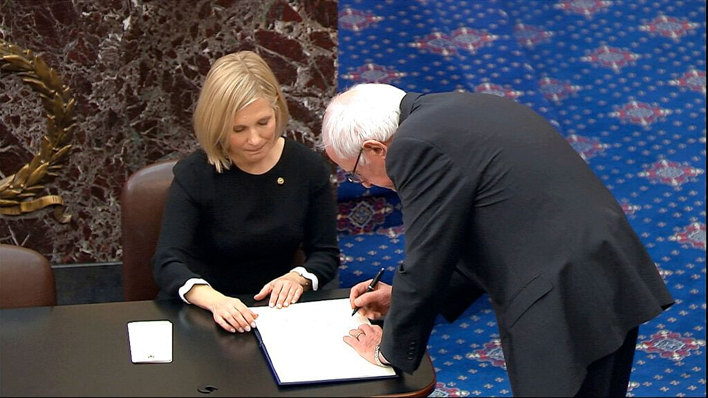 Senator Bernie Sanders signs the oath book after being sworn in for the impeachment trial of President Donald Trump in the Senate at the US Capitol in Washington, Thursday, 16 January 2020.