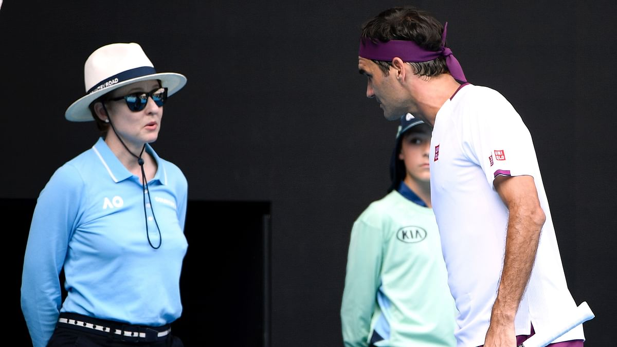 Federer was warned for an audible obscenity, reported by the line judge.
