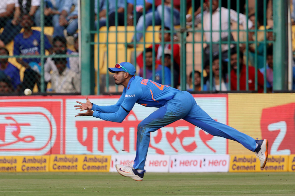 Shreyas Iyer of India takes a catch of Steven Smith of Australia during the 3rd One day International match between India and Australia.