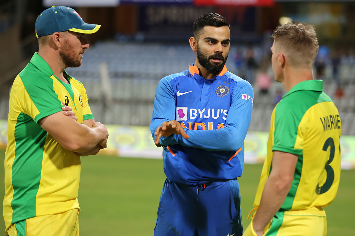 Virat Kohli Captain of India with Aaron Finch and David Warner of Australia during the 1st One day International match between India and Australia held at the Wankhede Stadium, Mumbai on the 14th Jan 2020.