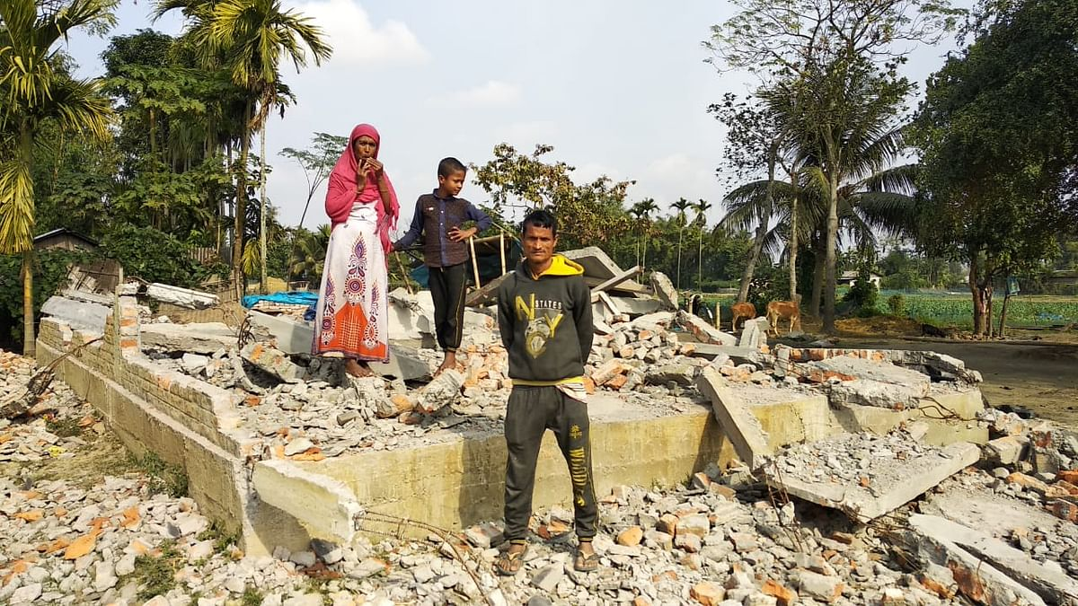A family whose house was demolished in Sootea on 5-6 December 2019.