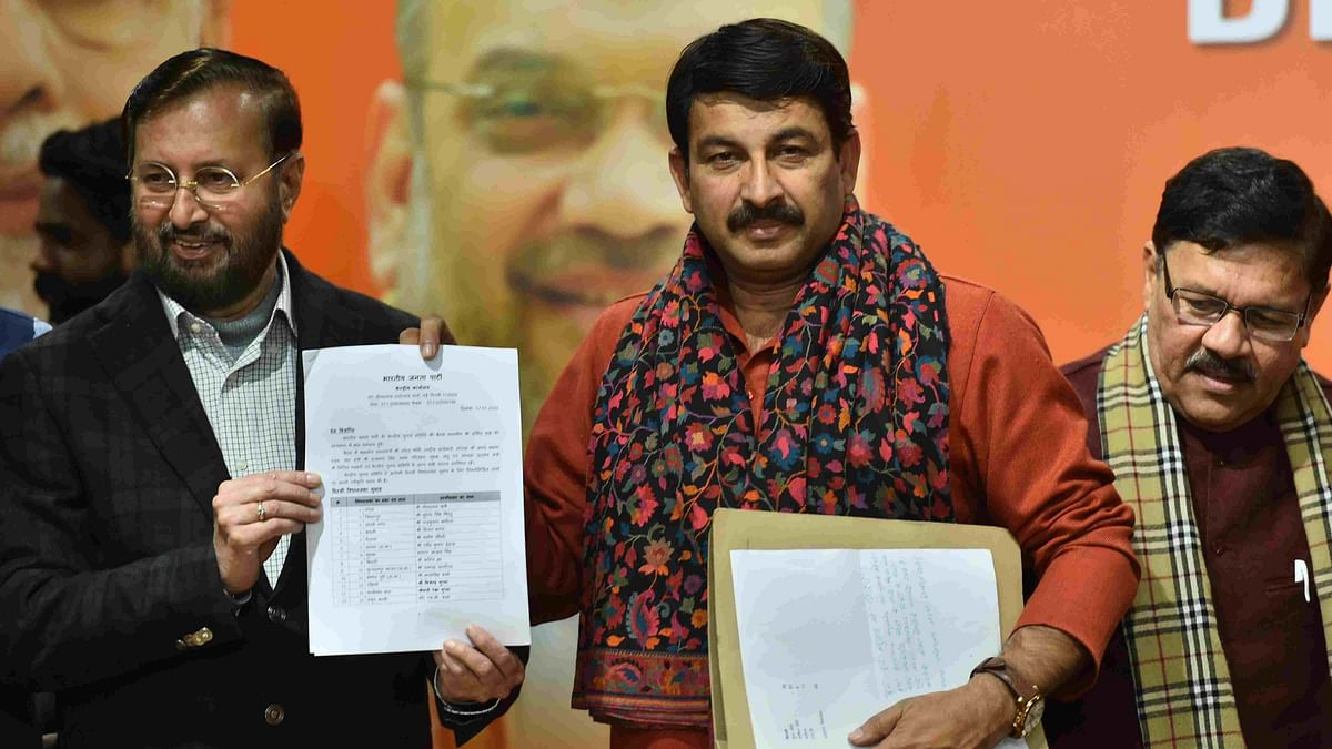 Delhi BJP Chief Manoj Tiwari with Union Minister Prakash Javadekar and BJP Vice-President Shyam Jaju during the release of BJP's first list of 57 candidates for Delhi Assembly polls.
