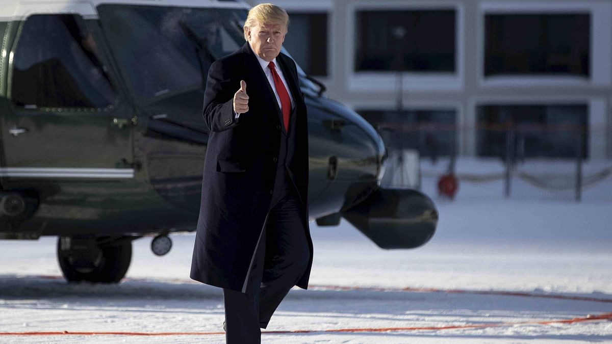 US President Donald Trump gestures as he arrives in Davos, Switzerland on 21 January.