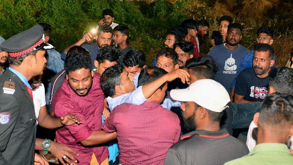 People rescuing an injured as a gallery of the stadium crashed and injured at least 50 people during a Charity Football Match in Palakkad on Sunday, 19 January.