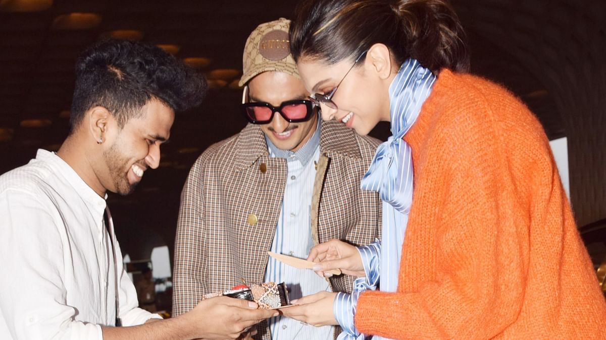 Pics: Deepika Cuts her Birthday Cake With a Fan at Mumbai Airport
