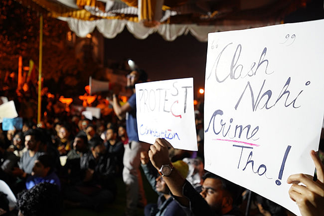 Protesters holding placards condemning  the attack on JNU students.