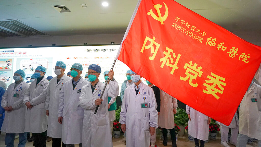 "In this Jan. 22, 2020, photo released on Thursday, Jan. 23, 2020, by China's Xinhua News Agency, medical workers of the Union Hospital with the Tongji Medical College of the Huazhong University of Science and Technology in Wuhan participate in a ceremony to form an ""assault team"" to battle against a coronavirus epidemic in Wuhan in central China's Hubei Province, Jan. 23, 2020."