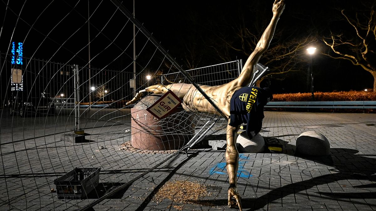 The damaged statue of soccer player Zlatan Ibrahimovic next to Stadion football arena in Malmo, Sweden, Sunday Jan. 5, 2020.