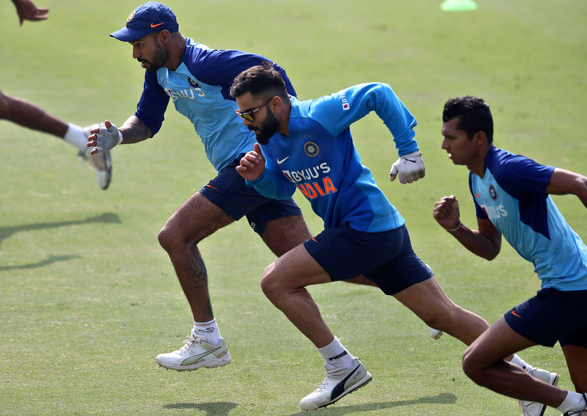 India's captain Virat Kohli, middle, and his team mates run during a training session ahead of their first Twenty20 cricket match against Sri Lankain Gauhati, India, Saturday, Jan. 4, 2020.