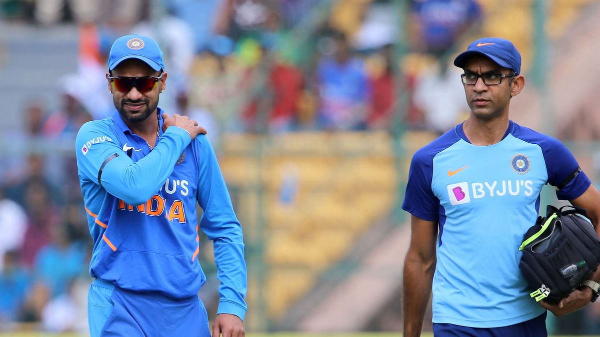 Shikhar Dhawan walks back to the pavalion after he got injured during the 3rd One day International match between India and Australia.