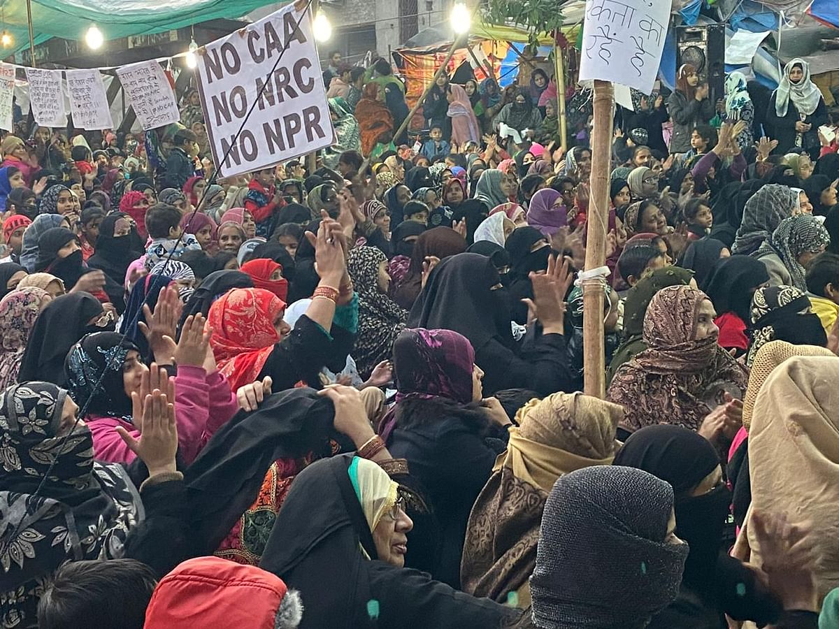 Women gather in Jamnapaar in Delhi to protests against CAA and NRC.