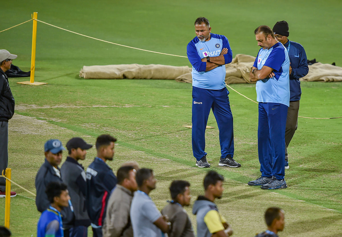 Head coach Ravi Shastri and batting coach Bharat Arun inspect the pitch during a practice session ahead of the 1st T20 cricket match against Sri Lanka, at Barsapara Cricket Stadium in Guwahati.