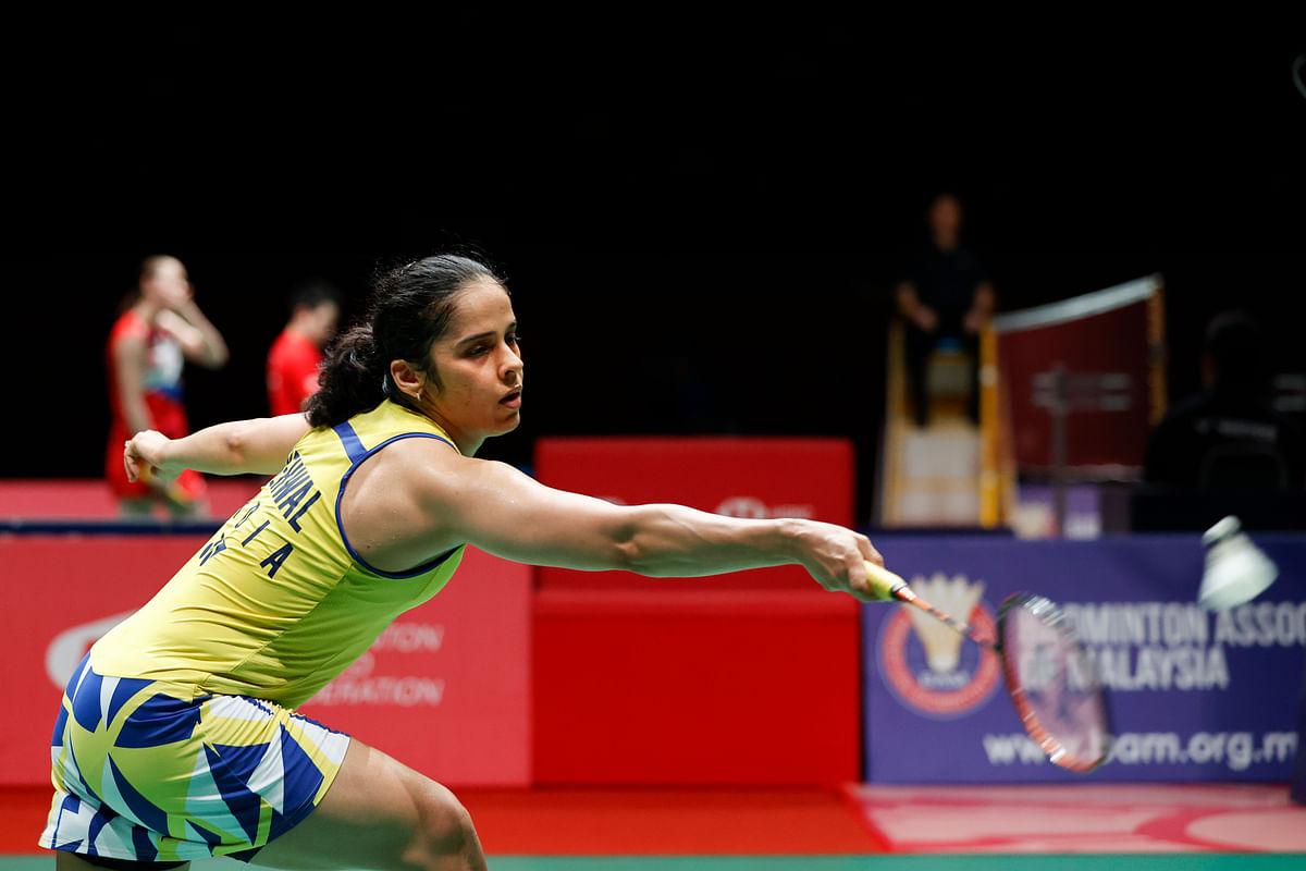 India's Saine Nehwal hits a return shot against Spain's Coralina Marin during their Malaysia Master women's single quarterfinal in Kuala Lumpur, Malaysia, Friday, Jan. 10, 2020.