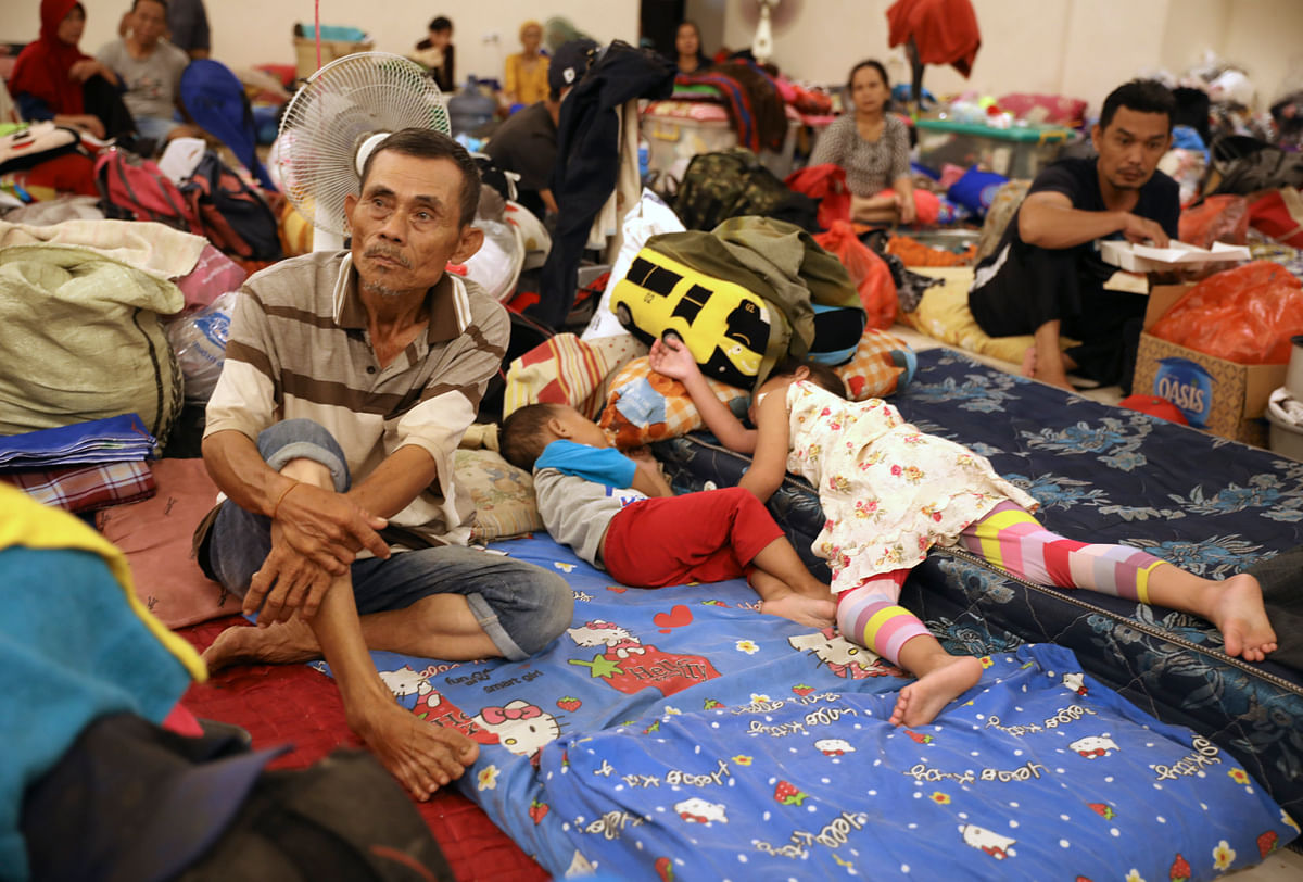 People rest at a temporary shelter for those affected by the floods in Jakarta, Indonesia.