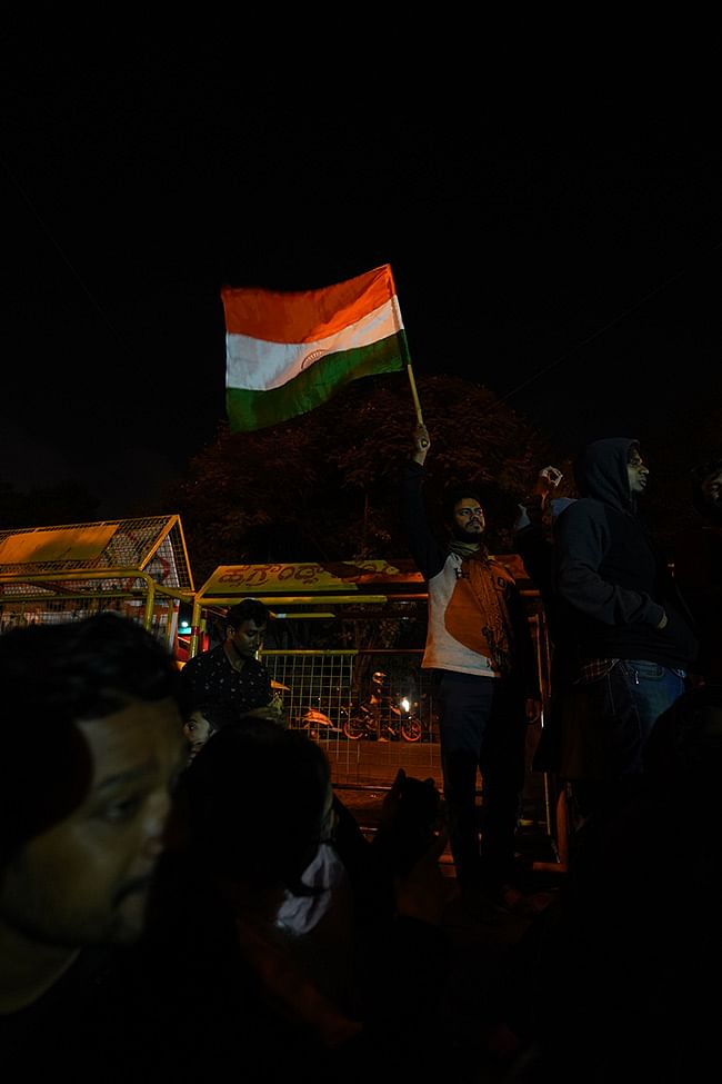 A protester waves the Indian flag during the demonstration at Bengaluru's Maurya Circle.