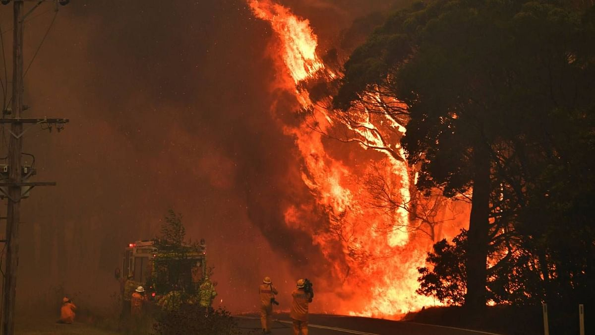 NSW Rural Fire Service crews fight the Gospers Mountain Fire as it impacts a structure at Bilpin.