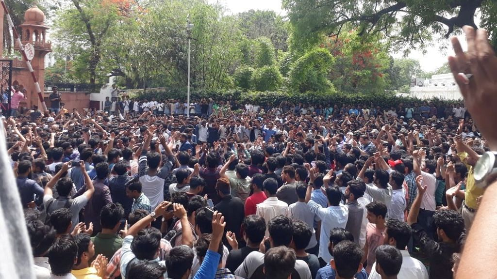 AMU stage a dharna in protest over the violence.