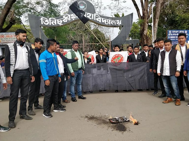 Protesters burn copies of CAA in front of Tinsukia College in Assam