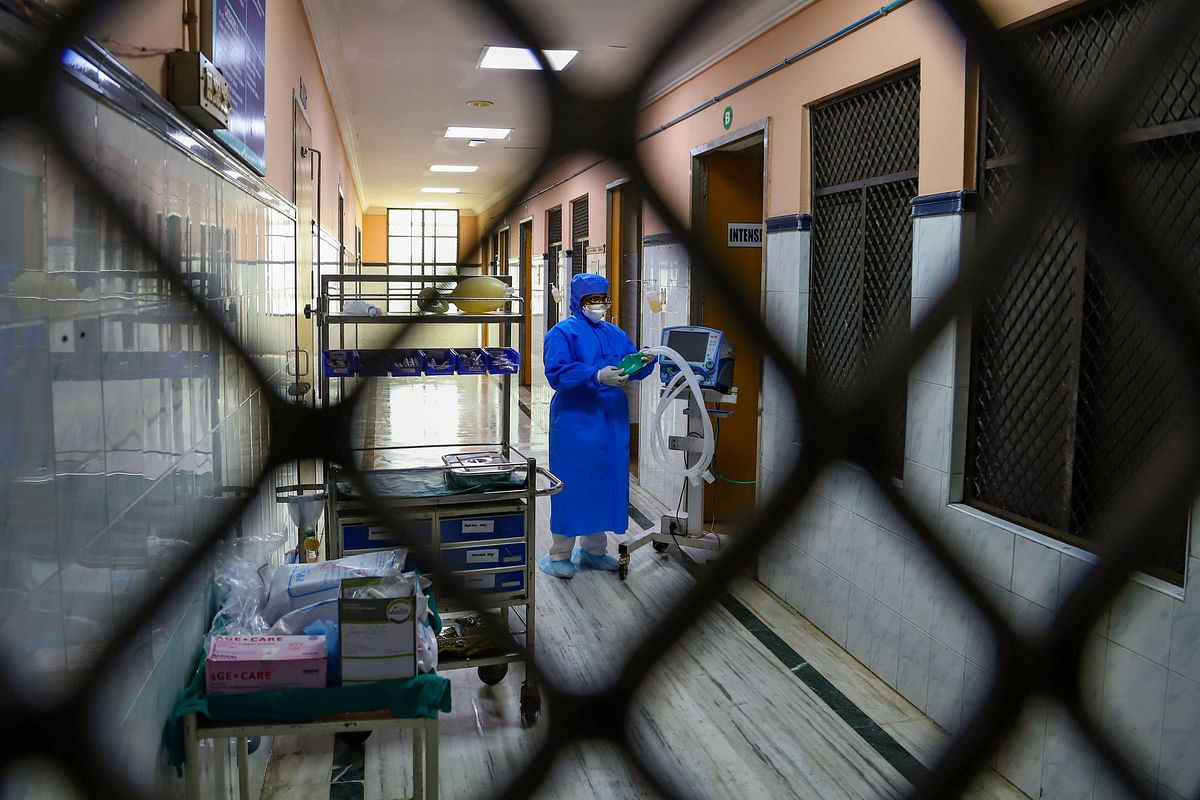 Hospital staff is seen outside the Special Isolation Ward set up to provide treatment to any suspected case of the coronavirus at the Rajiv Gandhi Government General Hospital, in Chennai.