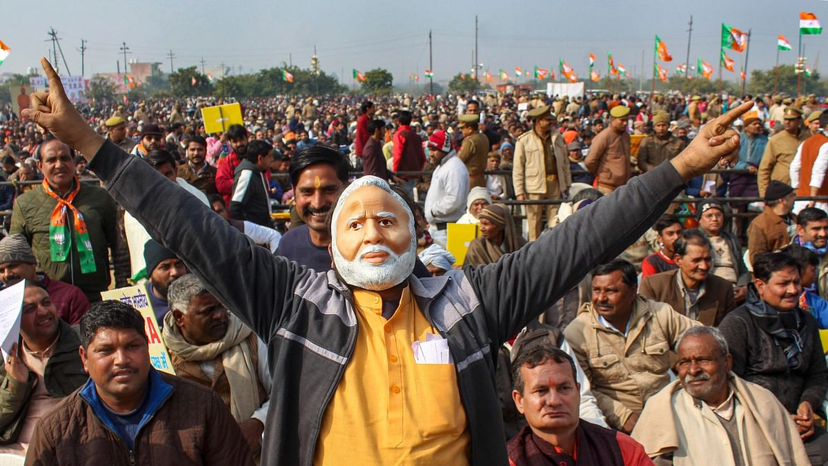 Supporters attend a pro-CAA rally by Union Defence Minister Rajnath Singh (unseen), in Meerut, Wednesday,22 January