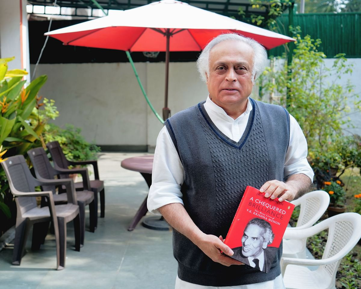 Senior Congress leader Jairam Ramesh holding a copy of his latest book, on VK Krishna Menon.