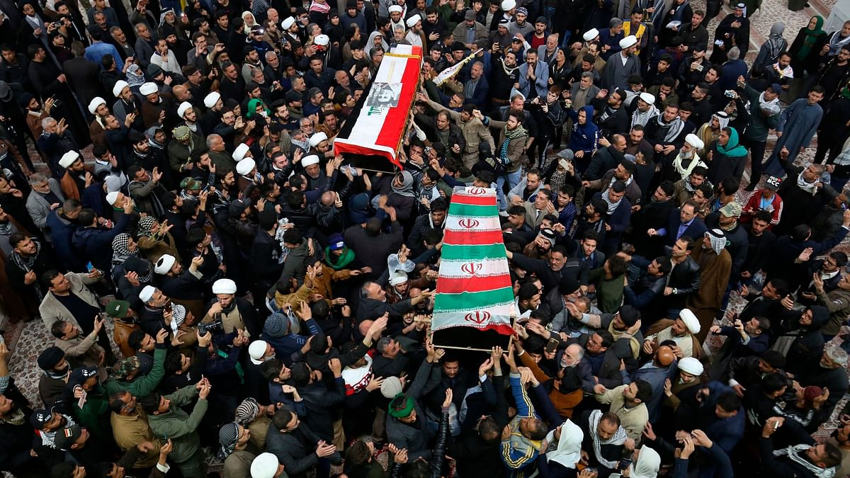 Mourners carry the coffins of Iran's General Qassem Soleimani and Abu Mahdi al-Muhandis, deputy commander of Iran-backed militias, at the Imam Ali shrine in Najaf, Iraq, Saturday, 4 January, 2020.