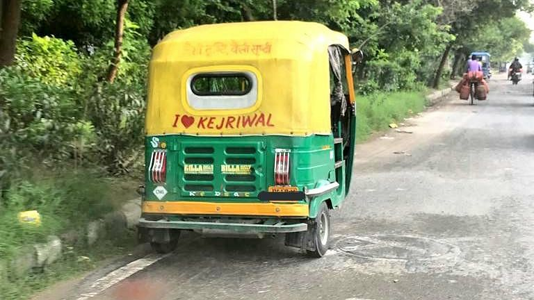 A plea challenged a Rs 10,000 challan issued to an auto driver for displaying 'I love Kejriwal' msg on his vehicle